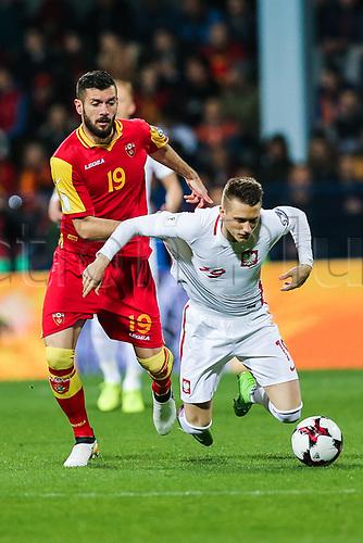 March 26th 2017, Podgorica City Stadium,  Montenegro; World Cup 2018 Internationl football qualification, Montenegro versus Poland;  Piotr Zielinski  (POL)is fouled by Aleksandar Scekic (MNE)