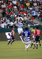 FC Dallas forward Atiba Harris (16) goes up high to receive a ball  during the first half of game between Chivas USA and FC Dallas at the Home Depot Center in Carson CA on June 26 2010. FC Dallas 2, Chivas USA 1.