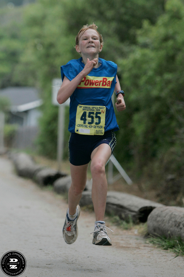 Julia Maxwell (455) of Ross races towards the finish line as the first female finisher at the 99th running of the Dipsea Race at Sintson Beach State Park on Sunday June 14th, 2009...
