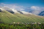 A late spring snowfall leaves a distinct snow line on the hills around Missoula, Montana