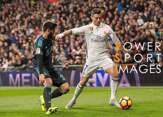 Cristiano Ronaldo (r) of Real Madrid battles for the ball with Raul Rodriguez Navas of Real Sociedad during their La Liga match between Real Madrid and Real Sociedad at the Santiago Bernabeu Stadium on 29 January 2017 in Madrid, Spain. Photo by Diego Gonzalez Souto / Power Sport Images