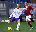 Calcio, Serie A: Roma vs Fiorentina. Roma, stadio Olimpico, 8 dicembre 2012..Fiorentina midfielder Borja Valero, of Spain, is chased by AS Roma defender Ivan Piris, of Paraguay, right, during the Italian Serie A football match between AS Roma and Fiorentina at Rome's Olympic stadium, 8 december 2012..UPDATE IMAGES PRESS/Isabella Bonotto