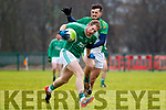Ballyduff's Padraig Boyle under pressure from Ballydonoghue's Michael Foley in the encounter in the North Kerry football final.