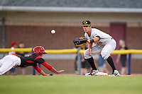 West Virginia Black Bears first baseman Chris Harvey (10) waits for a throw as Aaron Knapp (5) dives back to first during a game against the Batavia Muckdogs on June 28, 2016 at Dwyer Stadium in Batavia, New York.  Batavia defeated West Virginia 3-1.  (Mike Janes/Four Seam Images)