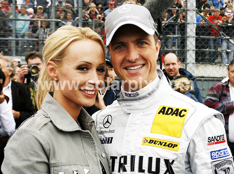 **ALL ROUND PICTURES FROM SOLARPIX.COM**.**SYNDICATION RIGHTS FOR UK AND SPAIN ONLY**.The German Formula one ace  Ralf Schumacher and his wife Cora seen at the  Deutsche Tourenwagen Masters (DTM) at the EuroSpeedway Lausitz in the town of Klettwitz in Gremany. .JOB REF:6450-CPR/Michael Urban      DATE:18_05_08.**MUST CREDIT SOLARPIX.COM OR DOUBLE FEE WILL BE CHARGED* *UNDER NO CIRCUMSTANCES IS THIS IMAGE TO BE REPRODUCED FOR ANY ONLINE EDITION WITHOUT PRIOR PERMISSION*