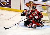 February 22nd 2008:  Josh Hennessy (23) of the Binghamton Senators collects a rebound in front of goalie Brian Elliott (1) during a game vs. the Rochester Amerks at Blue Cross Arena at the War Memorial in Rochester, NY.  The Senators defeated the Amerks 4-0.   Photo copyright Mike Janes Photography