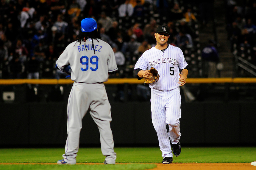 12 September 2008: Colorado Rockies outfielder Matt Holliday jokes with Los Angeles Dodgers outfielder Manny Ramirez as he jogs in between half-innings. The Dodgers defeated the Rockies 7-2 at Coors Field in Denver, Colorado. FOR EDITORIAL USE ONLY