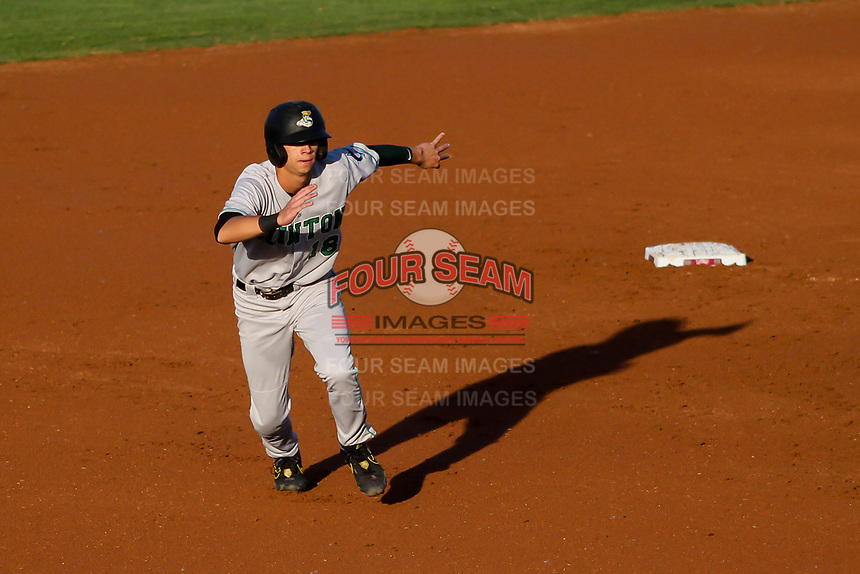 Clinton LumberKings Connor Scott (18) breaks for third base during a Midwest League game against the Wisconsin Timber Rattlers on June 20, 2019 at Fox Cities Stadium in Appleton, Wisconsin. Wisconsin defeated Clinton 5-2. (Brad Krause/Four Seam Images)