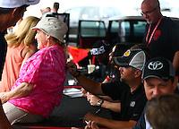 Apr 25, 2015; Baytown, TX, USA; NHRA top fuel driver Shawn Langdon during qualifying for the Spring Nationals at Royal Purple Raceway. Mandatory Credit: Mark J. Rebilas-