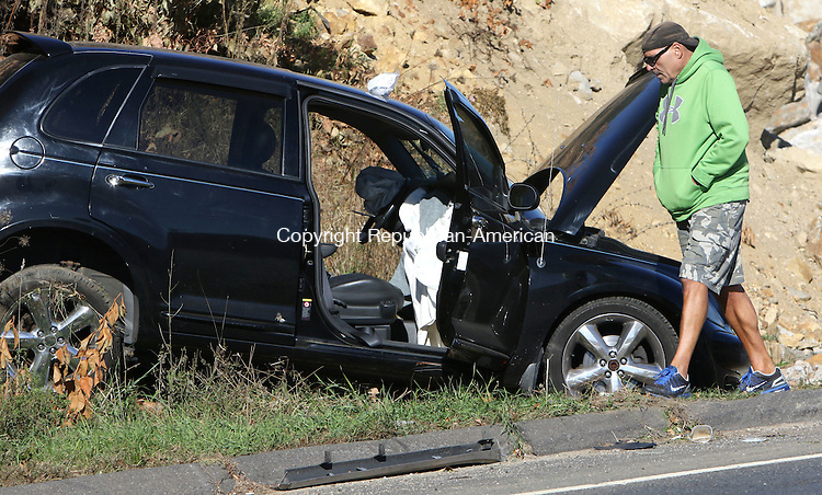 WATERBURY CT. 23 October 2015-102315SV01-A black vehicle involved in an accident sits along side Watertown Avenue in the are of Municipal Stadium in Waterbury Friday.<br /> Steven Valenti Republican-American