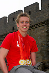 Multiple medal winner, Matthew Cowdrey  proudly display his many medals on the Great Wall of China, Badaling.