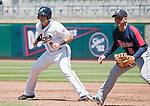 Reno Aces runner Mike Jacobs takes his lead as Tacoma Rainiers first baseman Luis Rodriguez holds him on the base during their game played on Monday, May 7, 2012 in Reno, Nevada