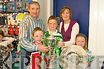 FAMILY RUGBY: Rugby family Mike, Conor, Patrick, Annette and Niamh Brodrick from Listry with the Grand Slam and Treble Crown trophies at O2 shop in the Square, Tralee on Sunday.