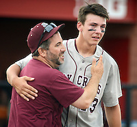 Holy Cross coach Steve Paolini congratulates pitcher Jeff Undercuffler #13 after defeating Gill St. Bernard's to win the NJSIAA South Jersey Non-Public B championship baseball game Tuesday June 7, 2016 at Rutgers University in Piscataway, New Jersey.  (Photo by William Thomas Cain)