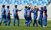 Afghanistan V USA cricket in Dubai Sports City Cricket Stadium - Afghan players celebrate a wicket - Picture by Donald MacLeod 11.02.10