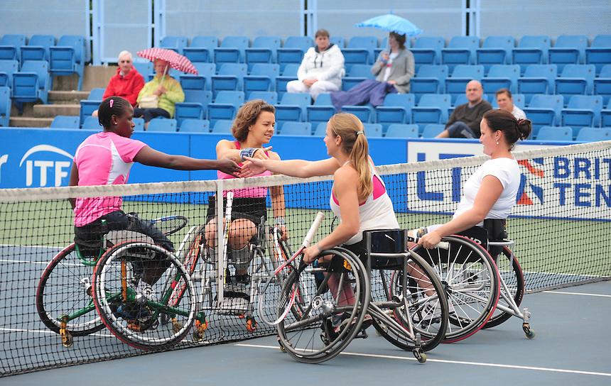 From left, Kgothatso Montjane (RSA), Marjolein Buis (NED) [3], Jiske Griffioen (NED) and Aniek Van Koot (NED) [1] after the Women's Doubles Final - Jiske Griffoen (NED) and Aniek Van Koot (NED) [1] def Majolein Buis (NED) [3] and Kgothatso Montjane (RSA) 6-2 7-5<br /> <br /> Tennis - British Open Wheelchair Tennis Championships - Sunday 21st July 2012 - Nottingham Tennis Centre - Nottingham<br /> <br /> &copy; Tennis Foundation/James Jordan - The National Tennis Centre - 100 Priory Lane - Roehampton - London - SW15 5JQ - Tel 020 8487 7304 - info@tennisfoundation.org.uk