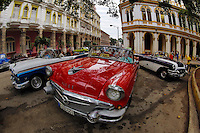 TH0488-D. Many vintage American cars now function as taxis for tourists in Old Havana (Habana Vieja in Spanish). Havana, Cuba.<br /> Photo Copyright &copy; Brandon Cole. All rights reserved worldwide.  www.brandoncole.com