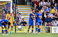 Lyle Taylor of AFC Wimbledon (center) Celebrates scoring his sides opening goal during the Friendly match between AFC Wimbledon and Crystal Palace at the Cherry Red Records Stadium, Kingston, England on 27 July 2016. Photo by Edward Thomas / PRiME Media Images.