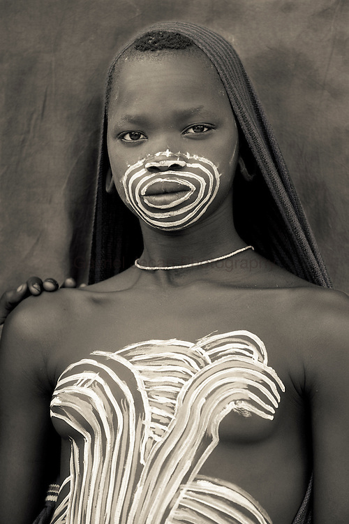 Portret of a young Surma girl with face paint