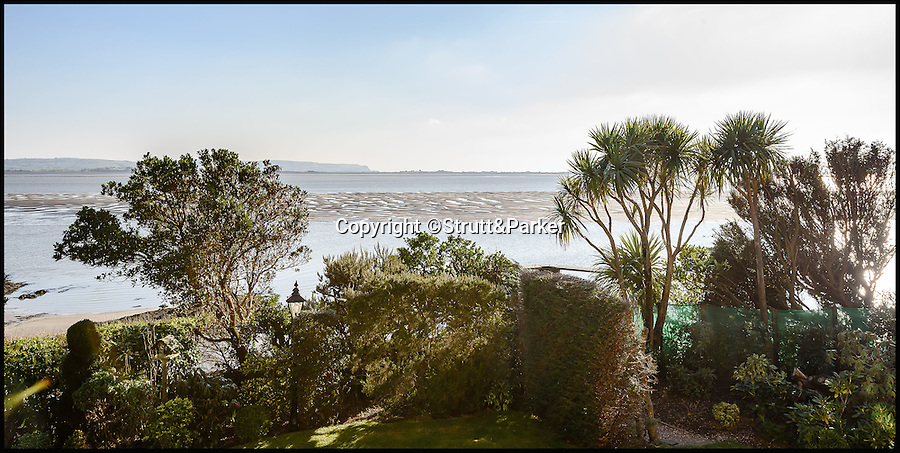BNPS.co.uk (01202 558833)<br /> Pic: Strutt&Parker/BNPS<br /> <br /> Stunning views.<br /> <br /> Go West...ultimate coastal hideaway with its own private island.<br /> <br /> A beautiful family home with its own private island is the perfect purchase for anyone with a sense of adventure.<br /> <br /> Trefri Hall is a stunning Grade II listed house with the Snowdonian hills as a backdrop and incredible views over the Dovey Estuary in mid Wales.<br /> <br /> But the real selling point is the small rocky island you can reach by bridge with your own castellated folly - ideal for pirate games or a spot of hide and seek.<br /> <br /> The house is up for sale with Strutt & Parker for £1.75million.