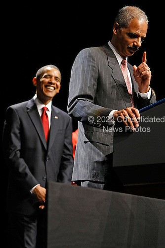 Washington, DC - March 27, 2009 -- United States President Barack Obama (L) laughs as U.S. Attorney General Eric Holder jokes about his basketball skills during his ceremonial installation at George Washington University March 27, 2009 in Washington, DC. Holder has been serving as the 82nd attorney general since he was confirmed by the Senate in February of this year.  .Credit: Chip Somodevilla - Pool via CNP