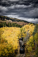 The Cumbres-Toltec narrow-guage train moves through a stand of autumn aspens in the San Juan Mountains near the Colorado/New Mexico border.