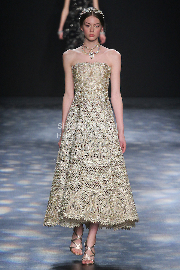Model Lauren walks runway in a gold ornate laser-cut and threadwork brocade strapless tea-length gown, from the Marchesa Fall 2016 collection by Georgina Chapman and Keren Craig, presented at NYFW: The Shows Fall 2016, during New York Fashion Week Fall 2016.