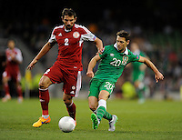 07/09/2015; UEFA Euro 2016 Group D Qualifier - Republic of Ireland v Georgia, Aviva Stadium, Dublin. <br /> Ireland&rsquo;s Wes Hoolahan with Ucha Lobzhanidze of Georgia.<br /> Picture credit: Tommy Grealy/actionshots.ie.
