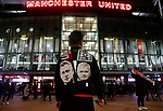 A fan wears a scarf adorned with the faces of Manchester United manager Ole Gunnar Solskjaer and Tottenham Hotspur manager Jose Mourinho before the Premier League match at Old Trafford, Manchester. Picture date: 4th December 2019. Picture credit should read: Darren Staples/Sportimage