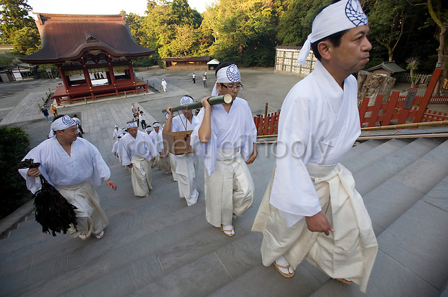 A box filled with seaweed is carried by priests through the Tsurugaoka Hachimangu shrine grounds during a purification ritual known as hamaorisai at the start of the 3-day Reitaisai festival in Kamakura, Japan on  14 Sept. 2012.  As a symbol of the purification, priests collect the seaweed from the sea and take it back to the shrine, hanging pieces around the shrine grounds to appease the gods. Photographer: Robert Gilhooly