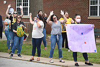 Well wishers comprised of teachers, staff and administrators cheer the arrival of Lee Elementary School principal Justin Swope Thursday, May 21, 2020, at the school in Springdale. Swope was recognized as the Arkansas Elementary Principal of the Year 2020 by the Arkansas Association of Elementary School Principals. Swope has been the principal at Lee Elementary School for nine years. Check out nwaonline.com/200522Daily/ and nwadg.com/photos for a photo gallery.<br /> (NWA Democrat-Gazette/David Gottschalk)