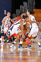 25 February 2012:  FIU guard Jerica Coley (22) handles the ball in the first half as the FIU Golden Panthers defeated the University of South Alabama Jaguars, 58-55 (OT), at the U.S. Century Bank Arena in Miami, Florida.