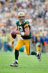 Green Bay Packers quarterback Aaron Rodgers (12) looks for a receiver during an NFL football game against the Buffalo Bills in Green Bay, Wisconsin on September 19, 2010. The Packers won 34-7. (AP Photo/David Stluka)
