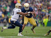 Navy quarterback Keenan Reynolds (19) pitches the ball as Notre Dame Fighting Irish linebacker Romeo Okwara (45) defends in the second quarter.