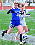 (Brockton MA 11/14/15) Dover-Sherborn 20, Graydon Wood and Medway 23, Alexa Rasmussen,  tangle near the sidelines, during  the division three south girls soccer final, Saturday, November 14, 2015, at Brockton High School. Herald Photo by Jim Michaud