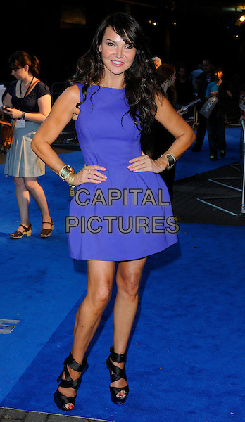 Lizzie Cundy.'Transformers: Dark Of The Moon' Fan screening at BFI IMAX Cinema, London, England..June 26th 2011.full length purple sleeveless dress hands on hips sandals.CAP/CAN.©Can Nguyen/Capital Pictures.