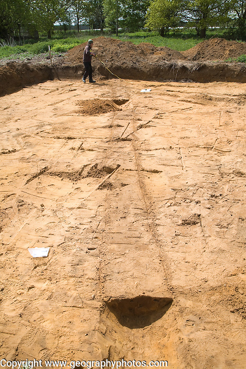 Archaeologists discover prehistoric field boundary ditch during excavation on new building plot, Shottisham, Suffolk, England