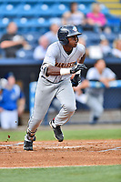 Charleston RiverDogs center fielder Estevan Florial (8) runs to first base during a game against the Asheville Tourists at McCormick Field on July 5, 2017 in Asheville, North Carolina. The RiverDogs defeated the Tourists 10-9. (Tony Farlow/Four Seam Images)