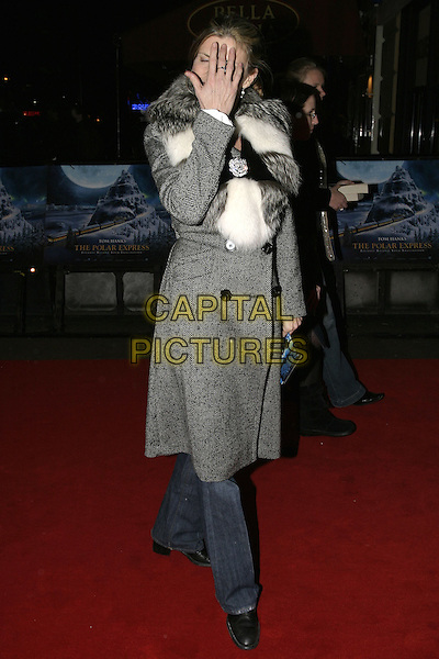 """SUSANNAH CONSTANTINE.Premiere of """"Polar Express"""", Vue cinema, Leicester Square, London, November 17th 2004..full length grey tweed coat white fur scarf brooch broach hiding hand funny.Ref: AH.www.capitalpictures.com.sales@capitalpictures.com.©Capital Pictures."""