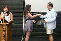 From left, Megan Sumida '14 and Larissa Saco '14 award Adjunct assistant history professor Paul Nam the Donald Loftsgordon Memorial Award for Outstanding Teaching during Senior Brunch and Class Day, May 16, 2014 in Rush Gym. (Photo by Marc Campos, Occidental College Photographer)