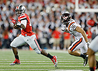 Ohio State Buckeyes quarterback J.T. Barrett (16) gets past Virginia Tech Hokies linebacker Chase Williams (36) during the 2nd quarter of their game in Ohio Stadium on September 6, 2014.  (Dispatch photo by Kyle Robertson)