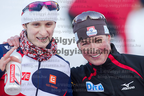 Czech Republic's Martina Sablikova (L) and Germany's Claudia Pechstein (R) celebrate their victory in Women's 5000m race of the Speed Skating All-round European Championships in Budapest, Hungary on January 8, 2012. ATTILA VOLGYI