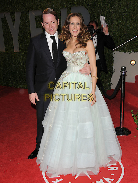 MATTHEW BRODERICK & SARAH JESSICA PARKER .at The 2009 Vanity Fair Oscar Party held at The Sunset Tower Hotel in West Hollywood, California, USA, .February 22nd 2009                                                                                      .oscars after party full length pale mint green dress strapless cleavage wavy hair brunette black suit tie husband wife long gown maxi waist belt .CAP/DVS.©Debbie VanStory/Capital Pictures