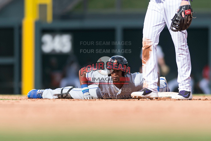 Surprise Saguaros center fielder Nick Heath (21), of the Kansas City Royals organization, watches a play at first base before standing up during an Arizona Fall League game against the Salt River Rafters at Salt River Fields at Talking Stick on October 23, 2018 in Scottsdale, Arizona. Salt River defeated Surprise 7-5 . (Zachary Lucy/Four Seam Images)