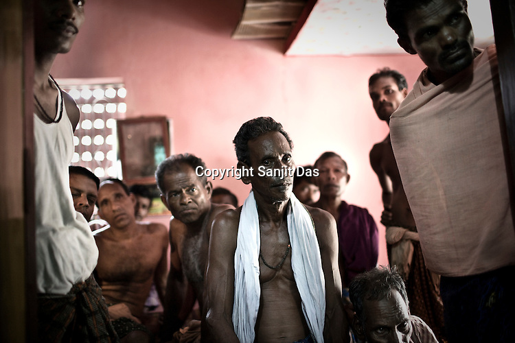 Local villagers gather to meet anti POSCO leader and the president of Posco Pratirodha Sangram Samiti, Mr. Abhaya Sahoo in Nuagaon in Orissa, India. PPSS leader Mr Abhaya Shaoo who had been spearheading Posco movement in Dhinkia panchyat since three years and took key role to paralyze the installation of Posco steel project was arrested by Paradip police on 2 th October in 2008. Sahoo had been languishing in jail since ten months has finally released on conditional bail in Orissa High Court.