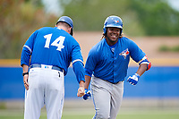 Toronto Blue Jays Vladimir Guerrero Jr. (6) is congratulated by manager John Schneider after hitting a home run in the third inning during a Minor League Spring Training Intrasquad game on March 31, 2018 at Englebert Complex in Dunedin, Florida.  (Mike Janes/Four Seam Images)