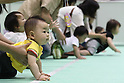 May 8, 2010 - Tokyo, Japan - Babies wait to start a 10 meters crawling competition called 'Babylympic' during the Maternity & Baby Festa 2010 show at Tokyo Big Sight, Japan, on May 8, 2010.Nearly 20,000 people are expected to attend the two-days annual event which features this season's maternity fashions, kids gear, pregnancy information sessions, maternity and exercise workshops for new mothers.