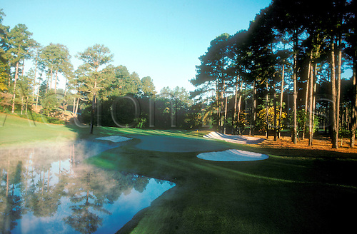 Augusta Golf Course Hole Number 16. The Augusta National Golf Club, located in Augusta, Georgia was founded by Bobby Jones and Clifford Roberts on the site of a former indigo plantation, the course was designed by Jones and Alister MacKenzie