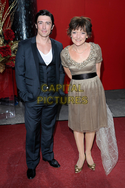 ADAM CROASDELL & GILLIAN WRIGHT.Arrivals - the British Soap Awards 2009, BBC Television Centre, Wood Lane, London, England..May 9th 2009.soaps tv full length gold dress black suit grey gray beige brown.CAP/FIN.©Steve Finn/Capital Pictures.