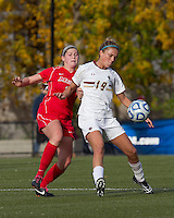 Boston College midfielder Kristen Mewis (19) controls the ball as Marist College midfielder/defender Jamie Strumwasser (3) pressures.  Boston College defeated Marist College, 6-1, in NCAA tournament play at Newton Campus Field, November 13, 2011.